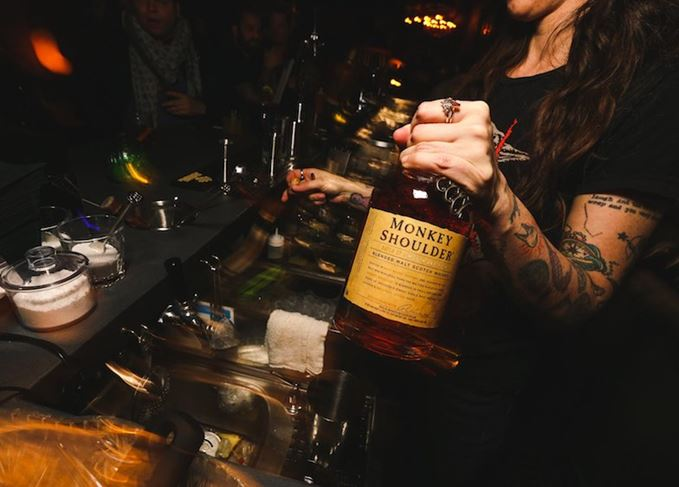 Bartender holding Monkey Shoulder blended malt whisky