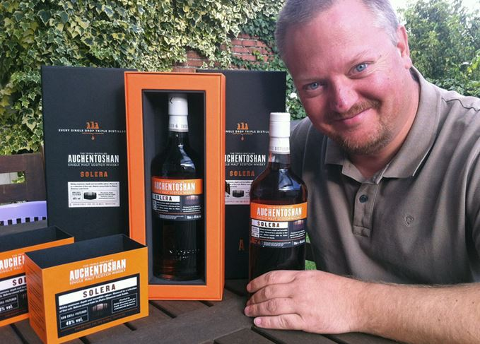 Whisky collector Mark Dermul with some bottles of Auchentoshan from his collection.