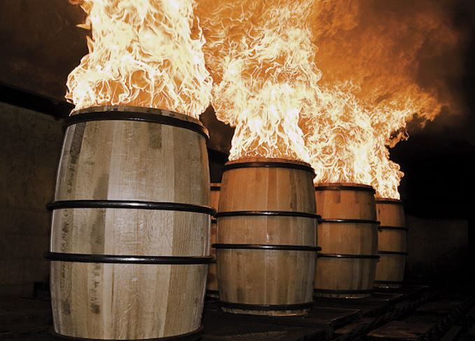 Casks being fired to char the insides