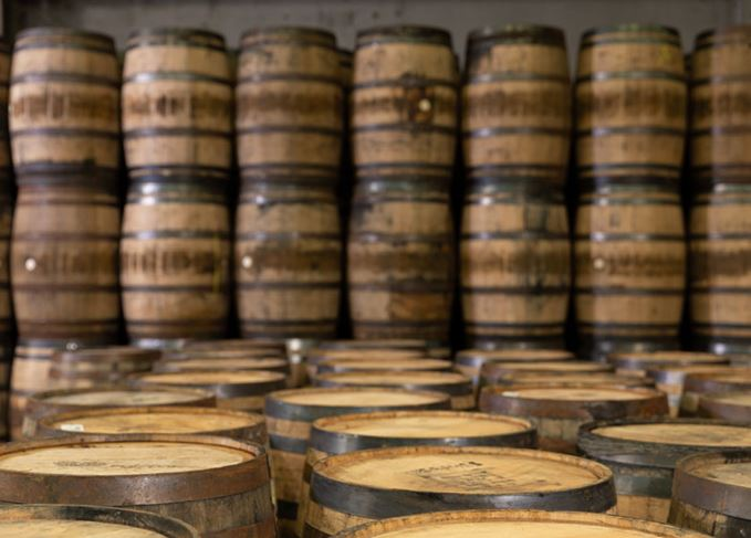 Rows of stacked whisky casks