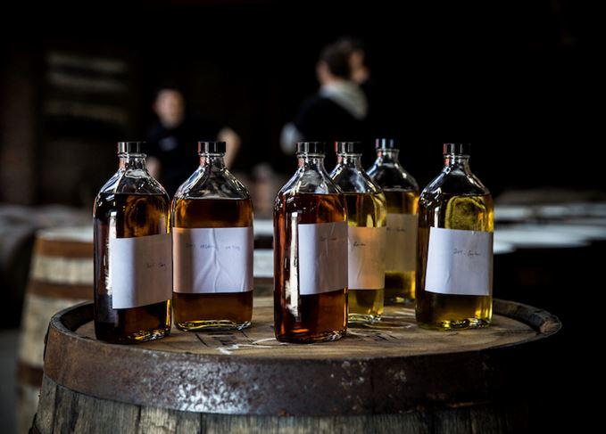 Whisky sample bottles on barrel end