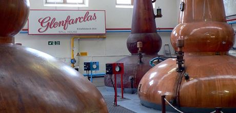 Why some distilleries use fire-heated stills