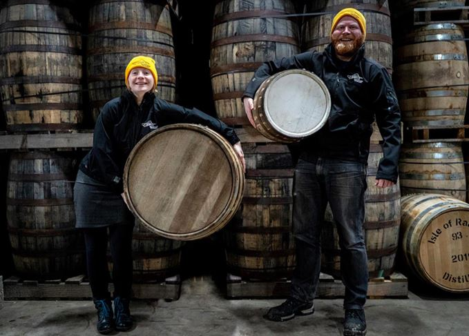 Isle of Raasay distillery staff holding 30-litre and 190-litre casks