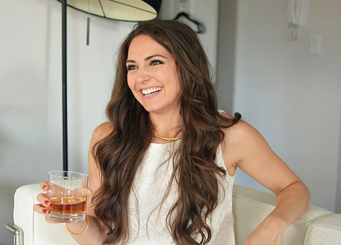 Allison Parc, founder of Brenne, drinking whisky