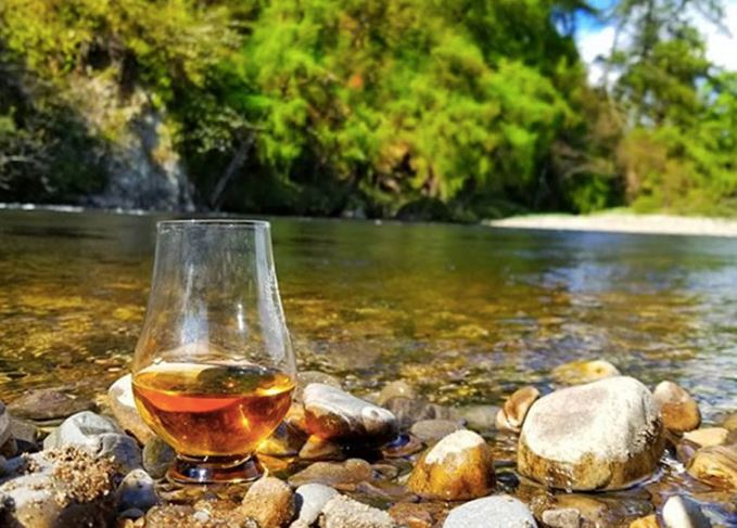 whisky glass on the Spey river