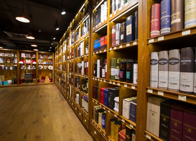 Shelves stocking whisky at The Whisky Exchange Covent Garden