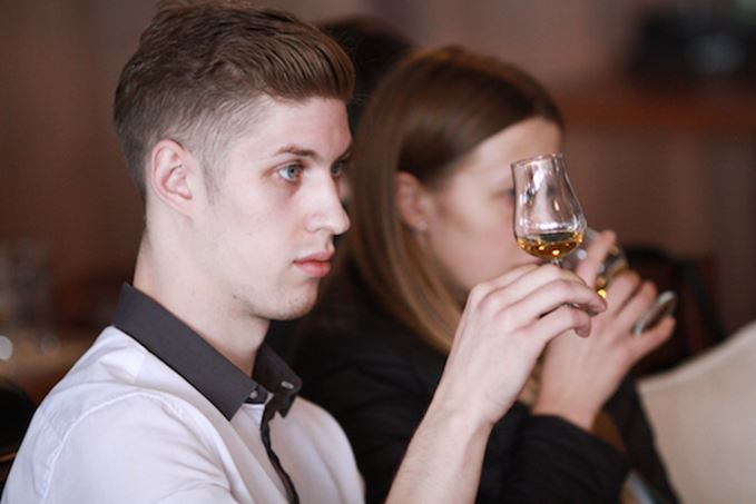 Men and women nosing whisky