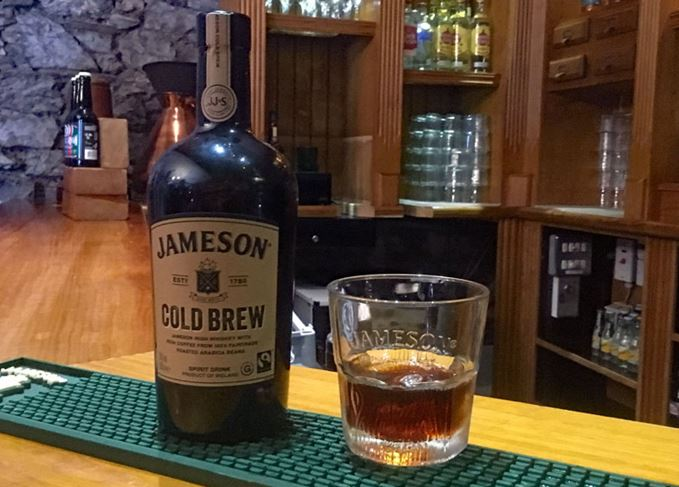 Jameson Cold Brew Irish whiskey coffee bottle with glass