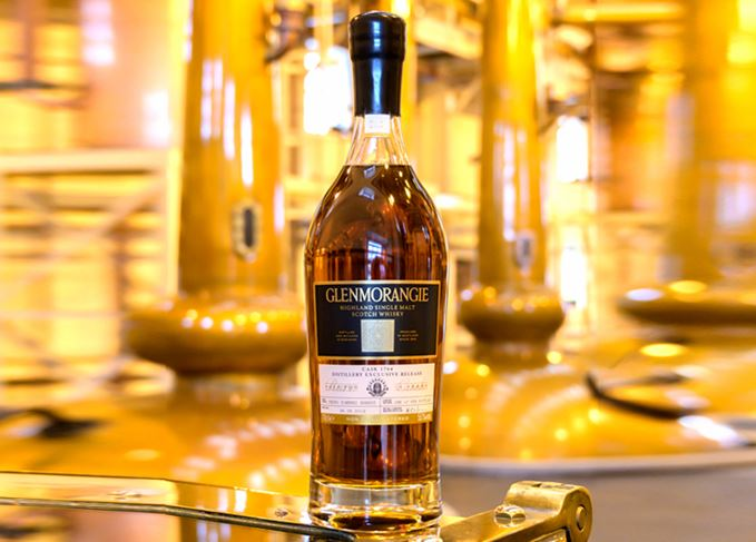 Glenmorangie cask 1784 in stillhouse stylised background