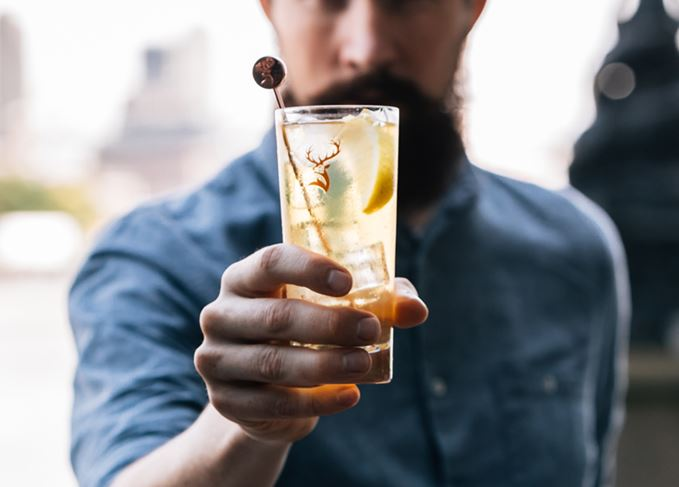 Man holding Highball
