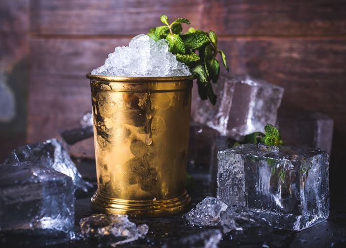 Mint Julep cocktail with ice blocks