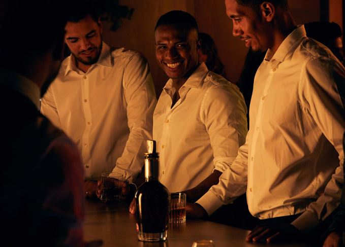 Manchester United players Sergio Romero, Antonio Valencia and Chris Smalling enjoying Chivas Regal