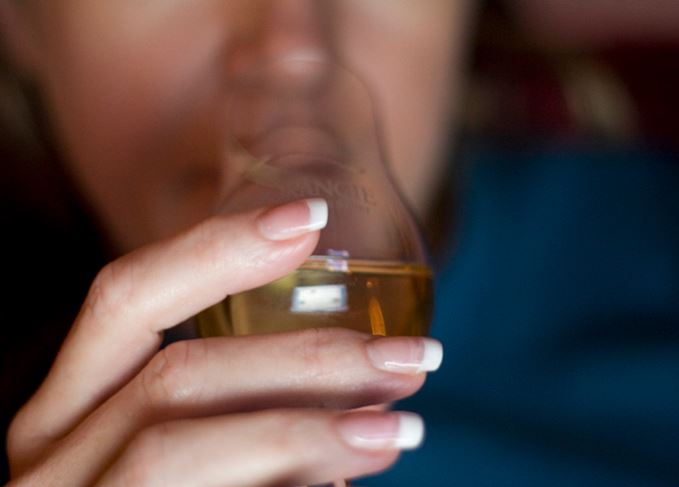 woman tasting whisky