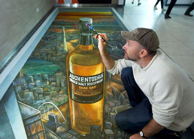 Joe Hill from 3D Joe & Max with the Auchentoshan mural at Edinburgh airport