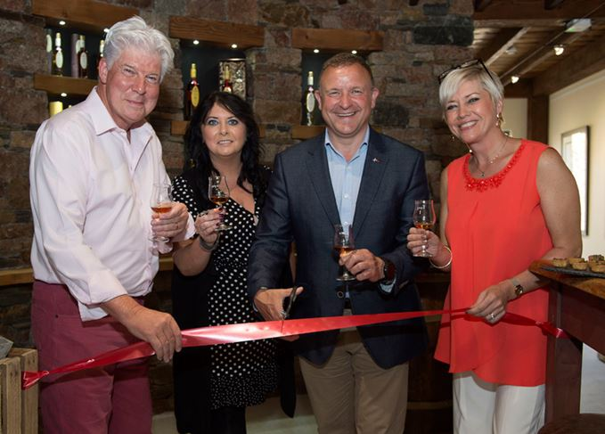 Speyside Distillers employees and Drew Hendry cutting ribbon