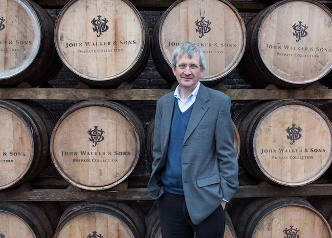 Jim Beveridge with John Walker whisky casks